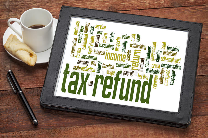 Tax refund word cloud. On a digital tablet with a cup of coffee royalty free stock image