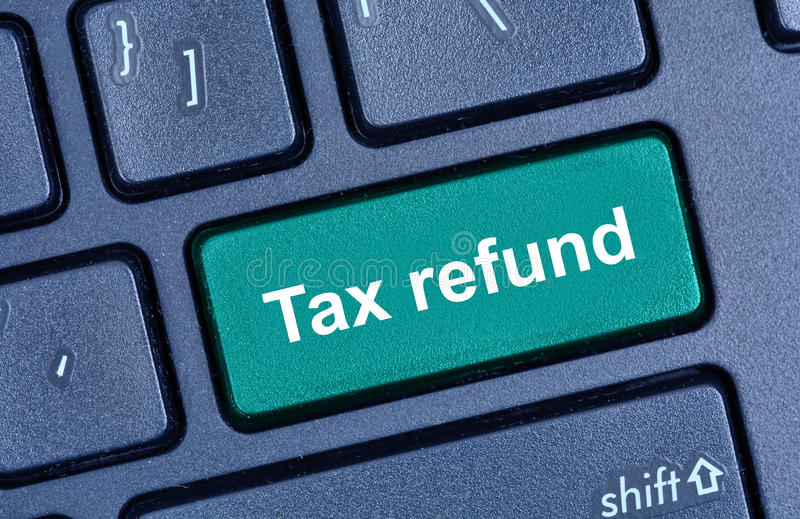 Tax refund words on computer keyboard. Button stock photo