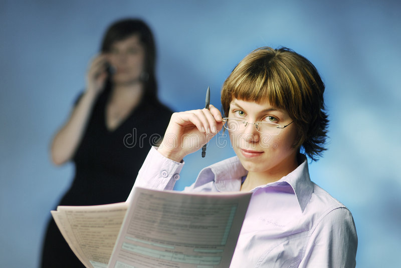With a tax return. Woman with a tax return stock image