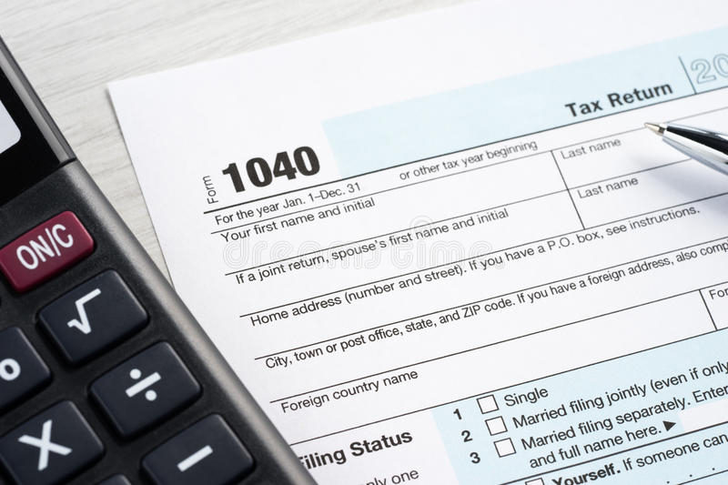 Tax return blank. Calculator and pen stock images