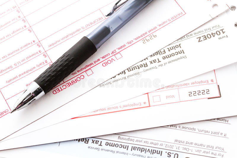 Tax return. Calculating numbers for income tax return with pen and calculato stock photos