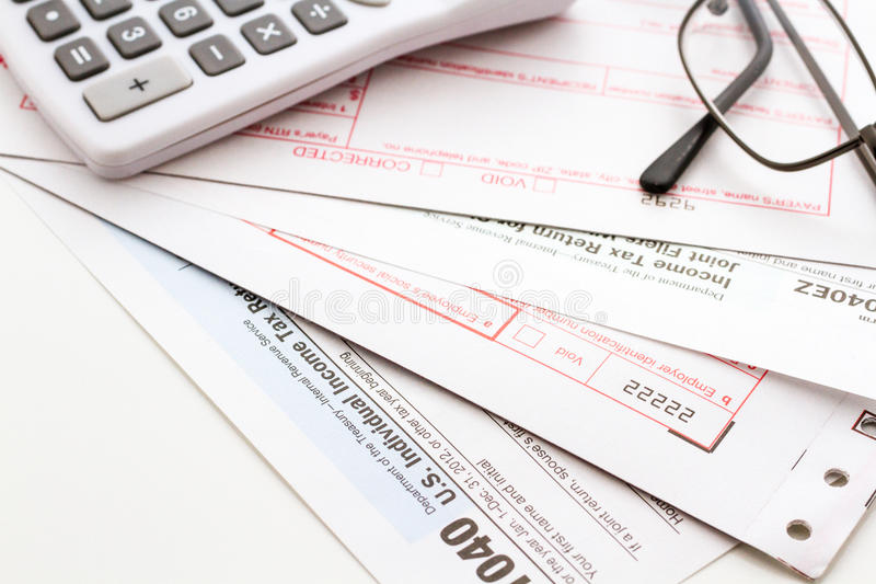 Tax return. Calculating numbers for income tax return with pen and calculato royalty free stock photos