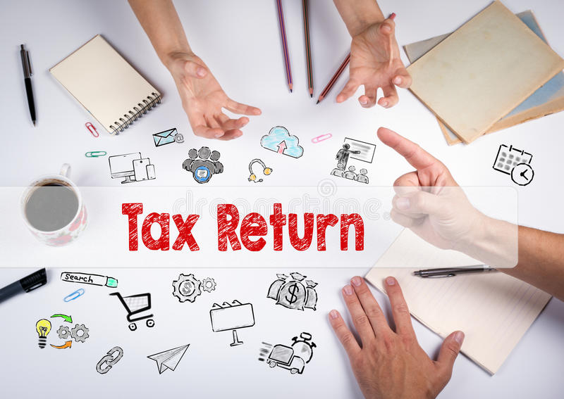 Tax return concept. The meeting at the white office table.  royalty free stock images