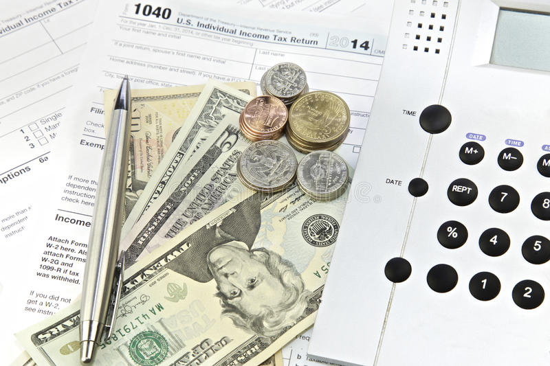Tax Return. Dollar bills, calculator and 1040 tax return form. US Federal Income Tax Forms royalty free stock photos