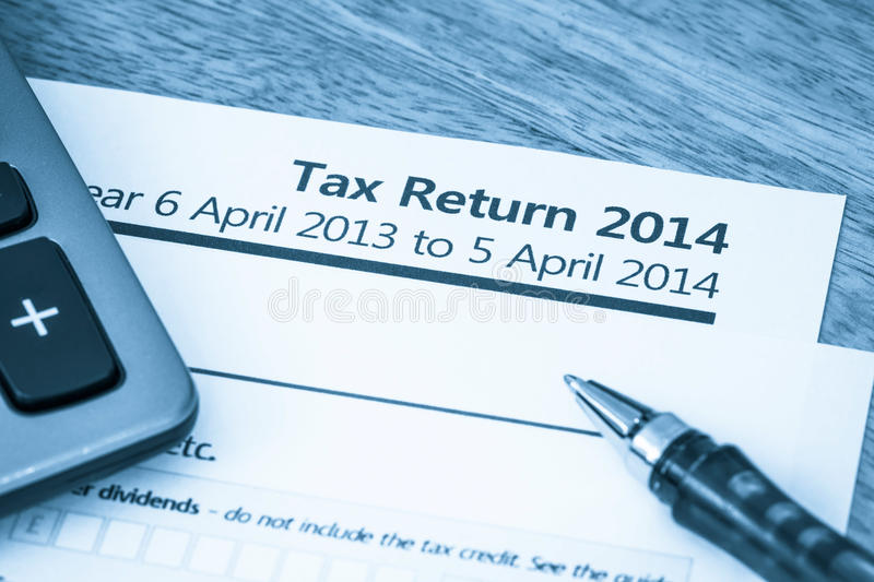 Tax return form 2014. Cool toned image of UK income tax return form for 2014 royalty free stock photos