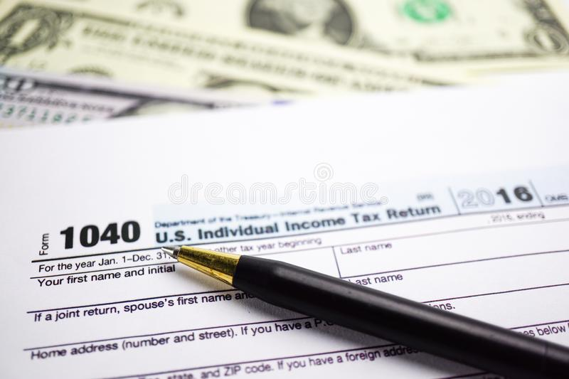 Tax Return form 1040 and dollar : U.S. Individual Income. stock photos