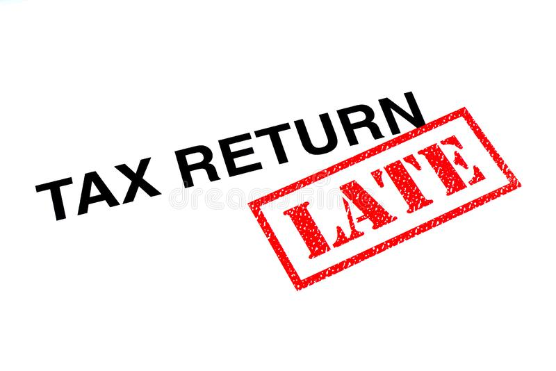 Tax Return Late. Tax Return heading stamped with a red LATE rubber stamp royalty free stock images
