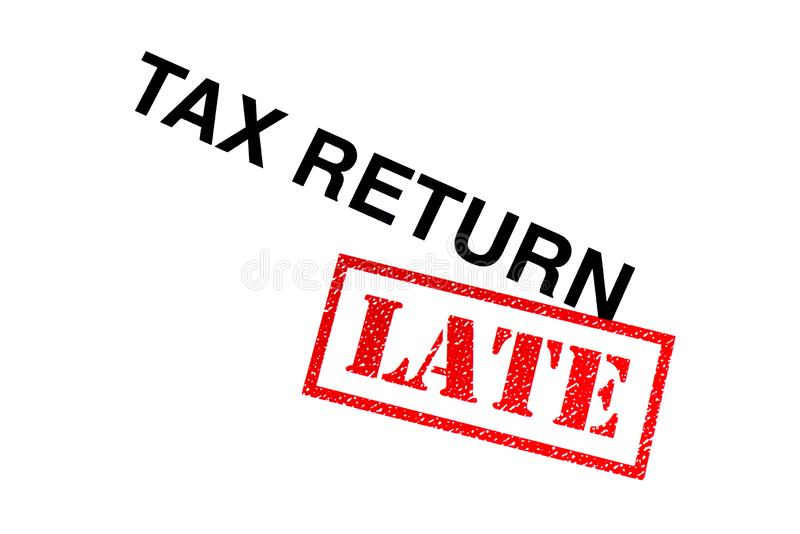 Tax Return Late. Tax Return heading stamped with a red LATE rubber stamp royalty free stock photography