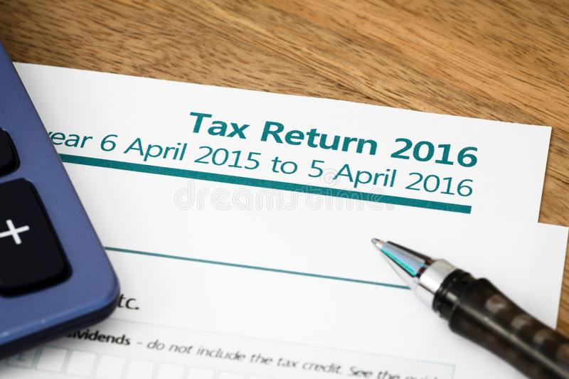 Tax return UK 2016. Close up of UK Income tax return form with tax period for 2016 royalty free stock images