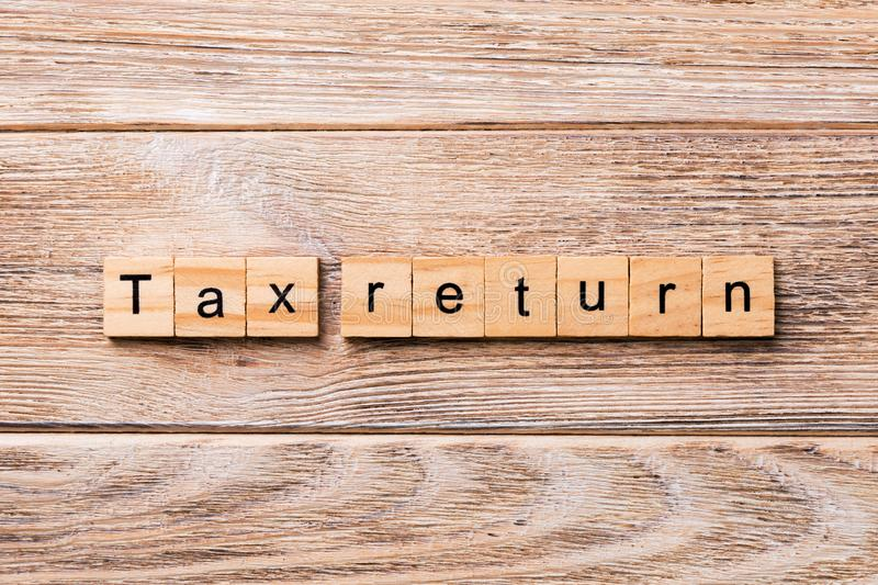 Tax return word written on wood block. tax return text on wooden table for your desing, concept.  royalty free stock image