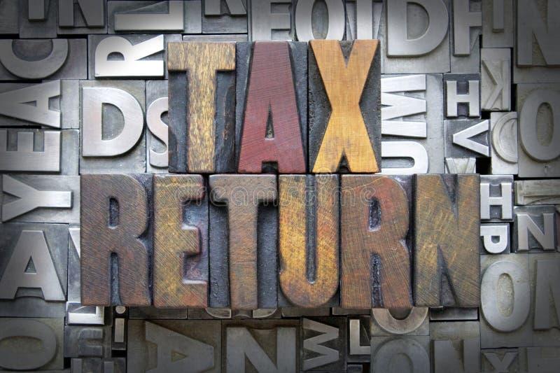 Tax Return. Written in vintage letterpress type stock photo
