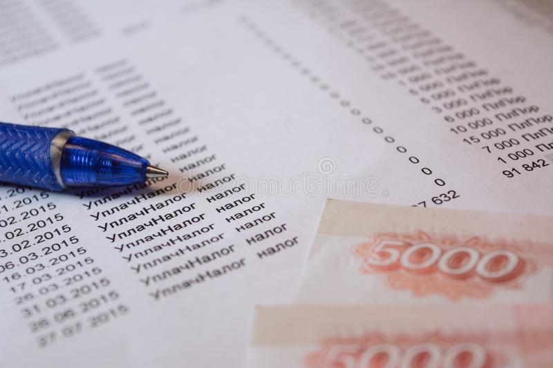 Tax sheet with pen and money royalty free stock photography