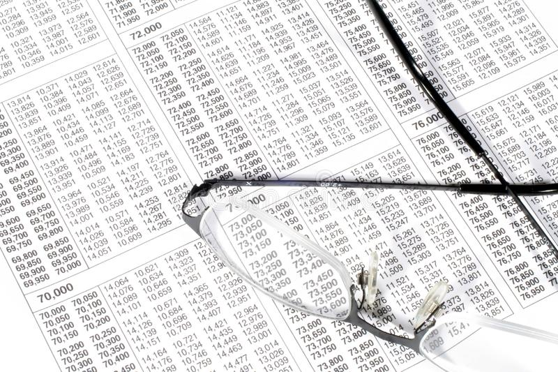 Tax Table and Glasses stock image