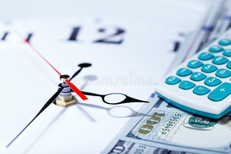 Tax time and alarm clock with money, banknote, dollars, calculator royalty free stock image