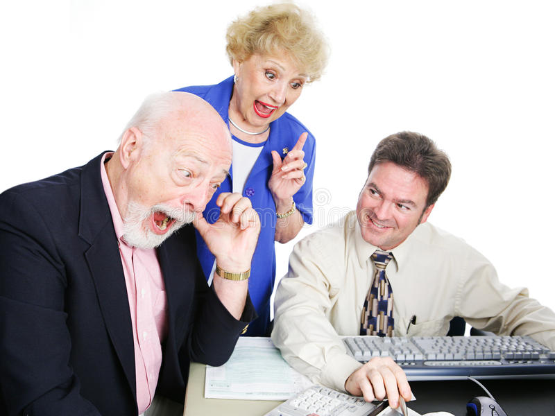 Tax Time - Big Refund. Seniors with their accountant, excited about getting a big tax refund. White background royalty free stock photography