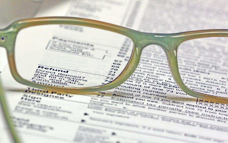 Tax Time - Refund. A pair of reading glasses on top of tax return form with the Refund section through the glasses stock photo