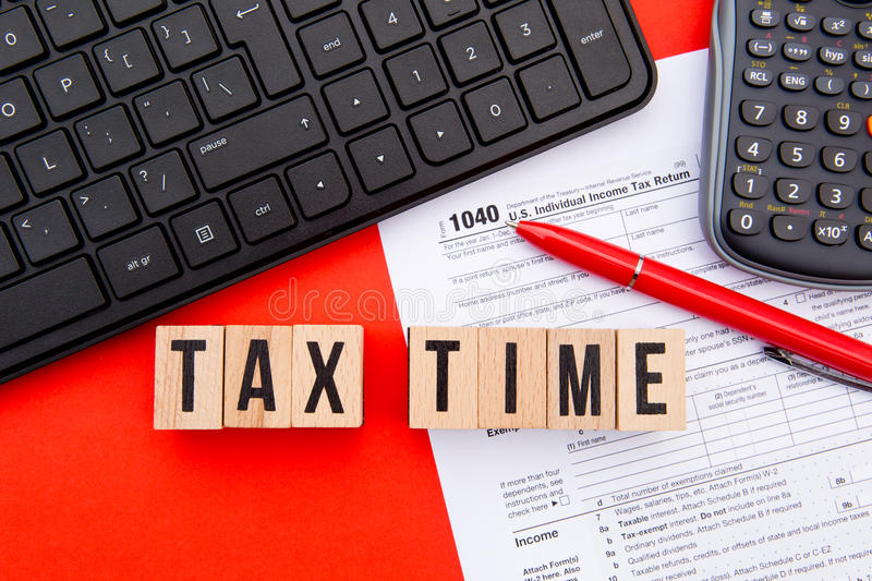Tax Time - USA. Wooden letters with 1040 Tax Form, keyboard and calculator royalty free stock images