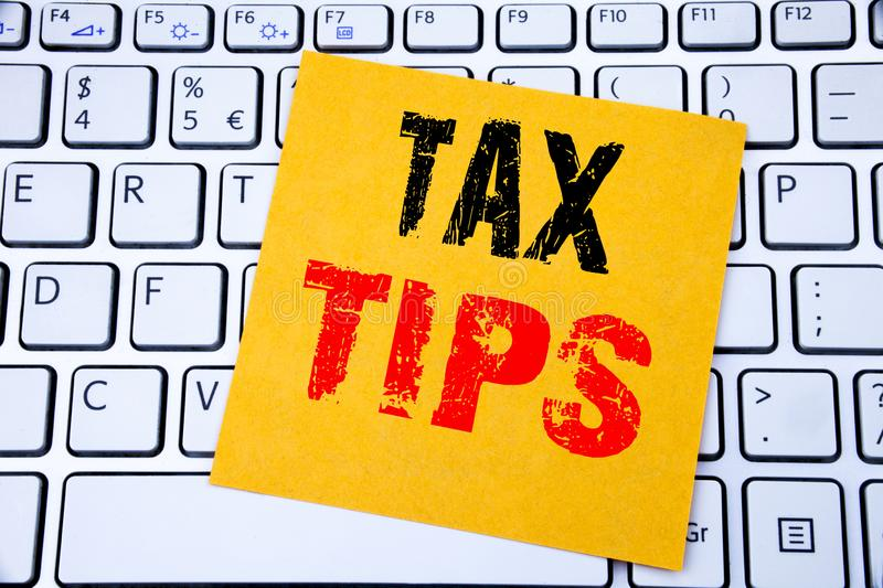 Tax Tips. Business concept for Taxpayer Assistance Refund Reimbursement written on sticky note paper on the white keyboard backgro. Tax Tips. Business concept royalty free stock photography