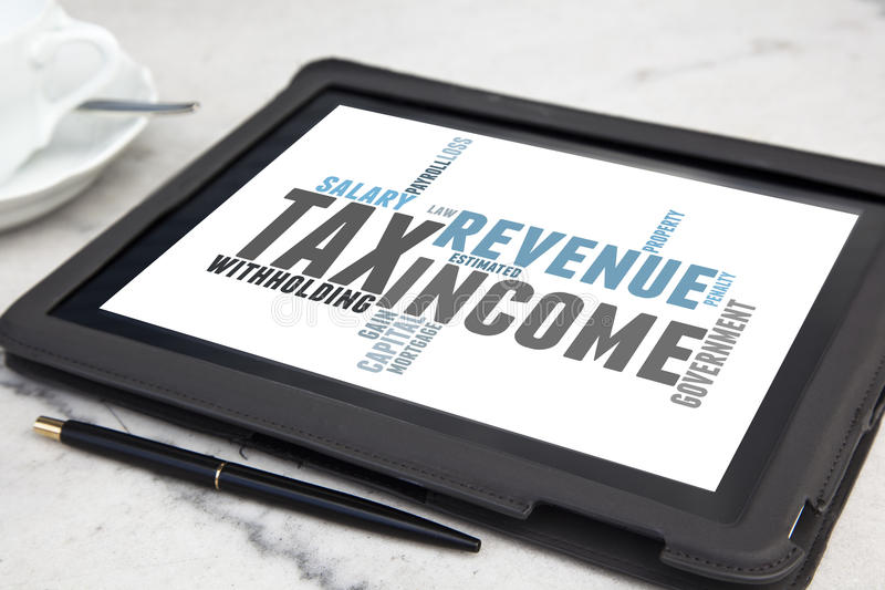 Tax word cloud. Tablet with tax word cloud stock image