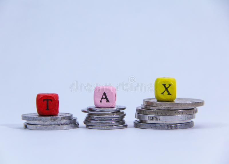Tax word concept with coin on white background. stock image