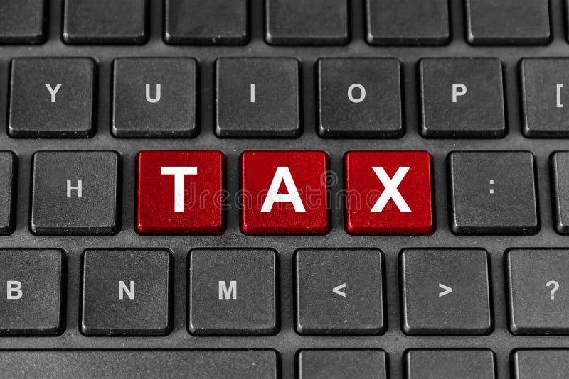 Tax word on keyboard royalty free stock photos