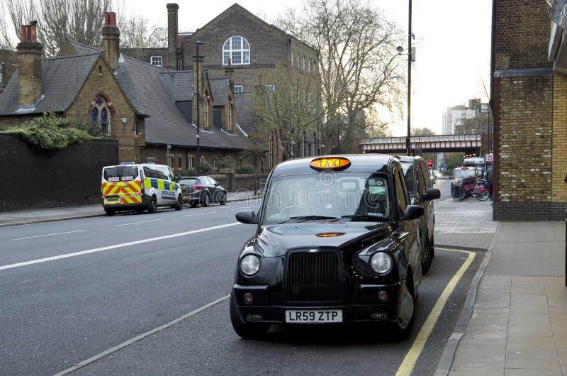 Taxa caben i London royaltyfri bild