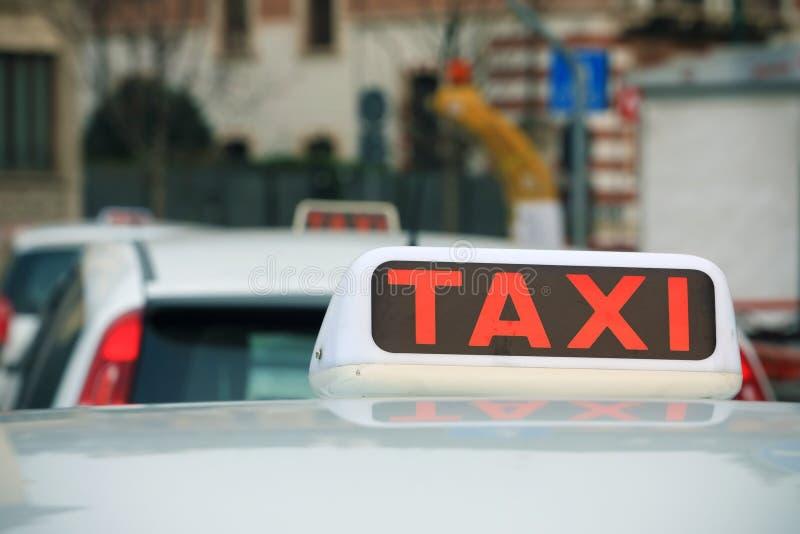 Taxa tecknet på en cab arkivfoto