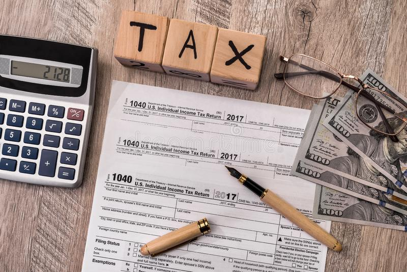 Taxation company on wooden table 1040 form with dollar.  royalty free stock photos