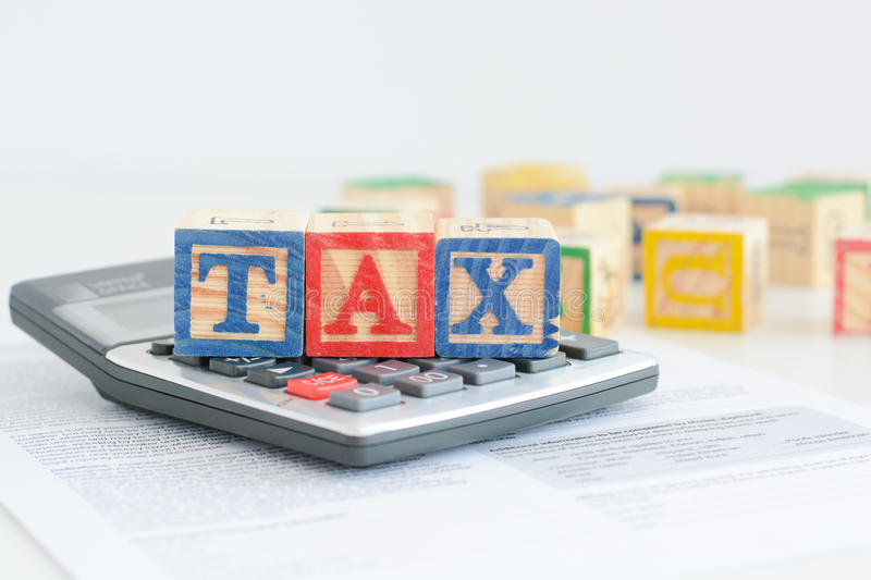 Taxation concept with wooden cubes and calculator royalty free stock image