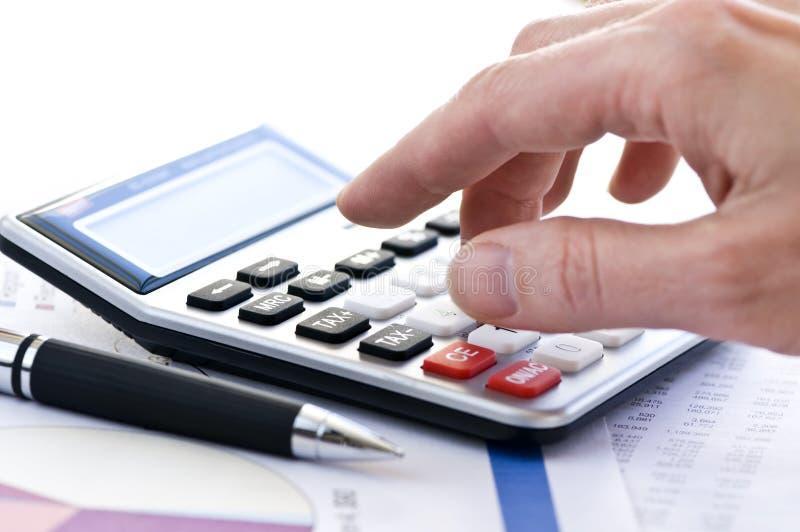 Taxe a calculadora e a pena fotos de stock royalty free