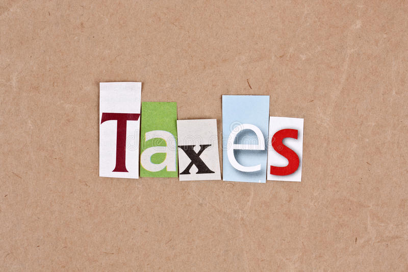 Taxes. Letters sorted on paper background royalty free stock image