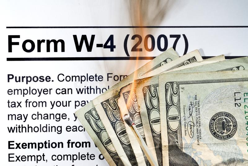Taxes. With high and ever increasing taxes, it is like burning your hard earned income with each year you file stock image