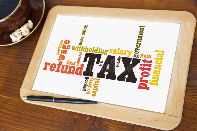 Taxes. Blackboard with tax word cloud royalty free stock images