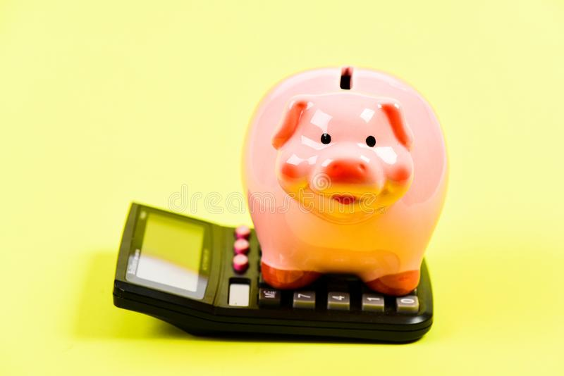 Taxes calculator. Accounting business. Piggy bank symbol money savings. Investments concept. Piggy bank pig and stock images