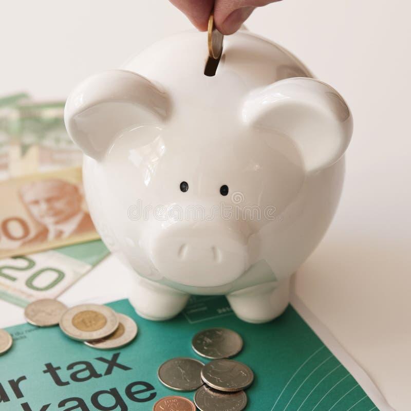 Taxes Canadian Money. Saving money to pay taxes in Canada royalty free stock photos