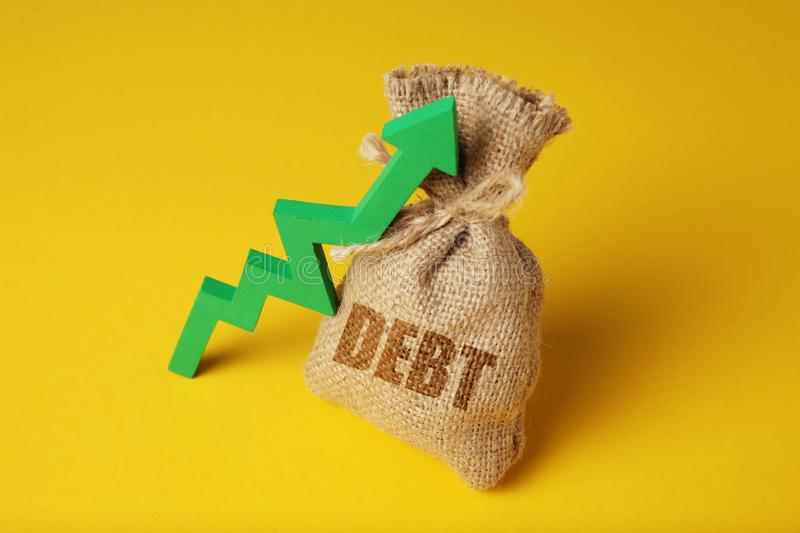 Taxes and interest on debt payments. Overdue payments, penalties. Green arrow up.  royalty free stock photography