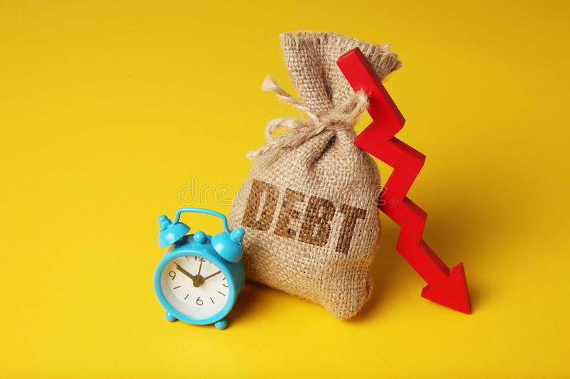 Taxes and interest on debt payments. Overdue payments, penalties. Red arrow down.  stock photos