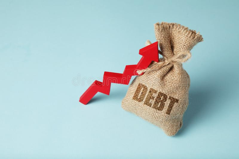 Taxes and interest on debt payments. Overdue payments, penalties. Red arrow and money bag.  stock photos