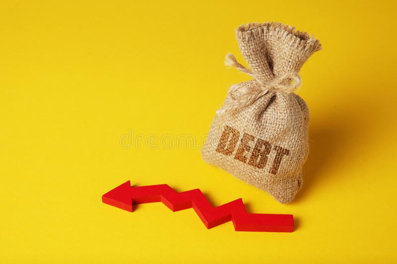 Taxes and interest on debt payments. Overdue payments, penalties. Red arrow.  royalty free stock photo