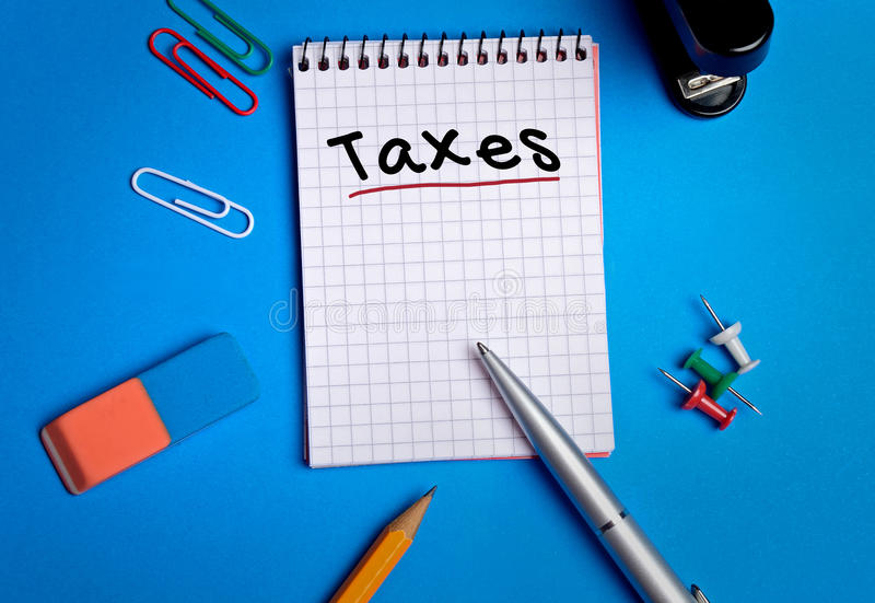 Taxes word. On notebook page royalty free stock photo