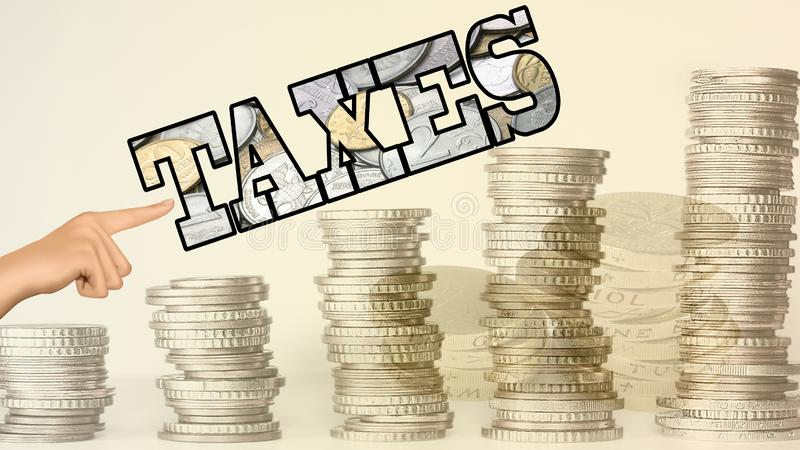 & x22;TAXES& x22; word with notes inscribed and coin stack in front royalty free stock photo