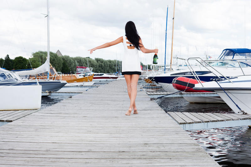 Taxi!. Young lady is looking for a boat taking her in royalty free stock photography