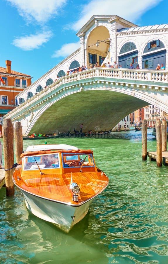 Taxi boat near Rialto bridge in Venice royalty free stock image