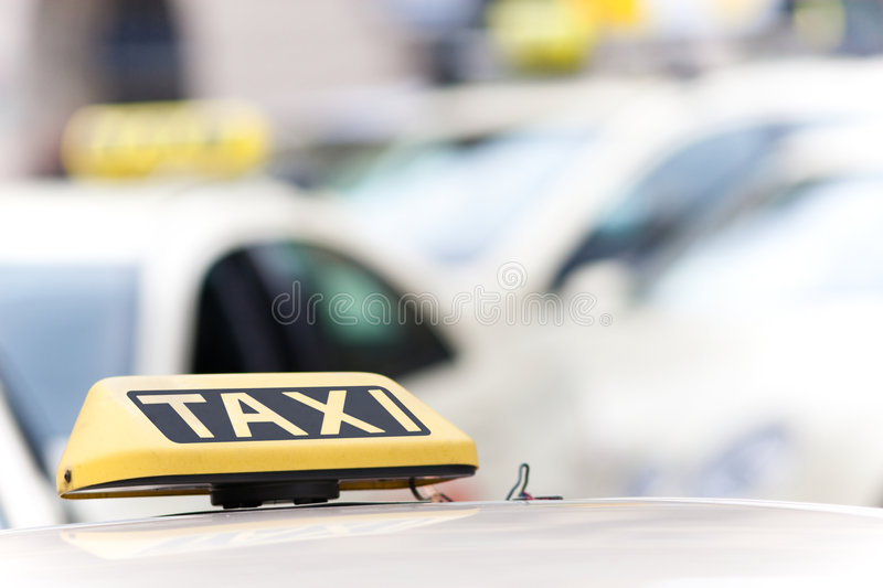 Download Taxi cab signs on vehicles stock photo. Image of yellow - 8811798