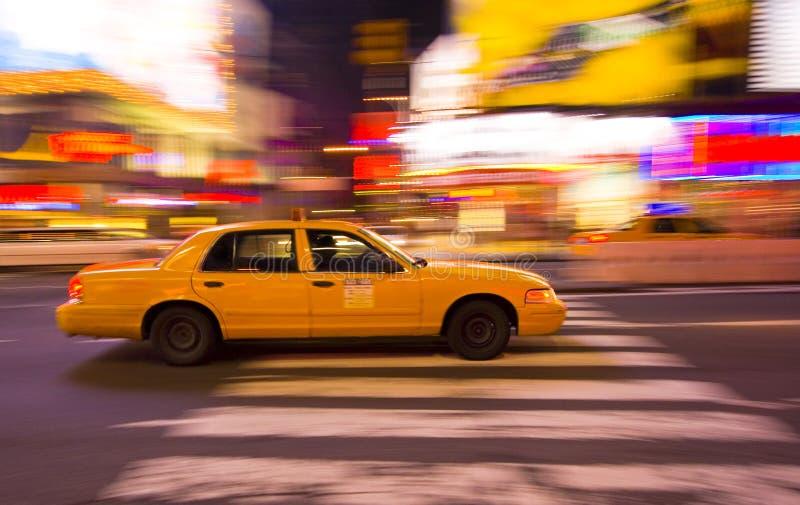 Taxi cab speeding through city stock photos