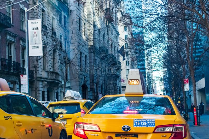 Taxi cabs and Buildings in NY Streets stock images