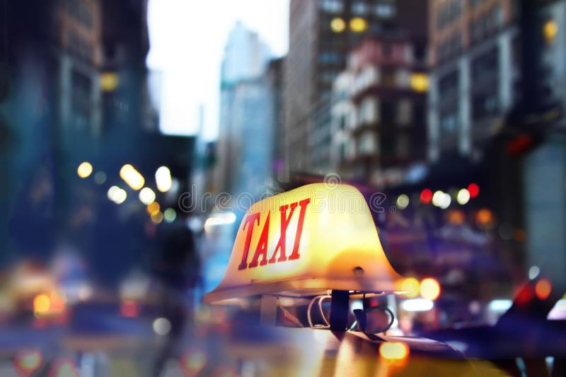Taxi car on the street at night. Taxi sign at night. Taxi car on the street at night. Selective focused image stock photo
