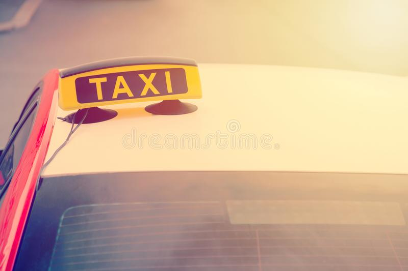 Taxi car is waiting for a passenger on the street. European tourism and travel concept. Toned.  stock photography