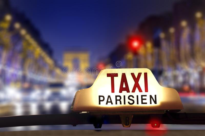 Taxi at the champs elysees stock photos