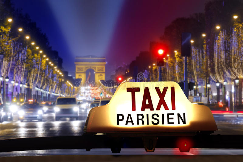 Taxi at the champs elysees stock photo